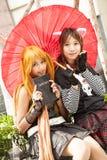 De jonge meisjes van Thais nemen aan een cosplay festival voor Siam Pagagon, Bangkok deel Royalty-vrije Stock Afbeelding