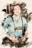 De jonge mens in Beiers lederhosen royalty-vrije stock foto's