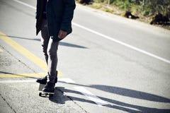 De jonge mens die, vignetted met een skateboard rijden Royalty-vrije Stock Foto