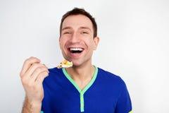 De jonge mens eet yoghurt Royalty-vrije Stock Foto's