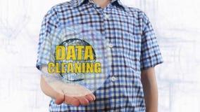 De jonge mens toont een hologram van aarde en tekstgegevens het schoonmaken royalty-vrije stock foto