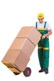 De jonge mensen bewegende die dozen met kar op wit wordt geïsoleerd Royalty-vrije Stock Foto's