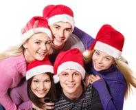 De jonge mensen van de groep in santahoed. Stock Afbeelding