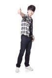 De jonge mensenstudent toont duim Stock Foto