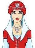 De jonge mooie vrouw in een rode tulband en zilveren juwelen Stock Foto's