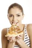 De jonge mooie vrouw eet pizza Stock Afbeelding