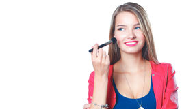 De jonge mooie vrouw houdt in hand borstel voor make-up royalty-vrije stock fotografie
