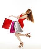 De jonge mooie vrouw maakt het winkelen Stock Foto's