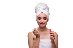 De jonge mooie vrouw met lippenstift op wit stock fotografie