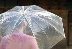 De jonge paraplu van de vrouwenholding Royalty-vrije Stock Foto