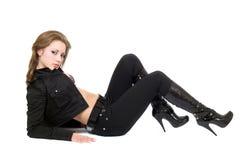 De jonge sexy vrouw in zwart kostuum. Stock Afbeeldingen