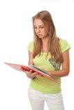 De jonge student met het boek Stock Afbeelding