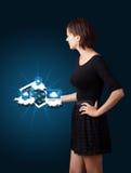 De jonge tablet van de vrouwenholding met moderne apparaten in wolken Stock Foto
