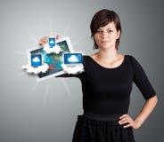 De jonge tablet van de vrouwenholding met moderne apparaten in wolken Stock Afbeelding