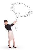 De jonge tekening van de de wolkenballon van de dameholding royalty-vrije stock foto
