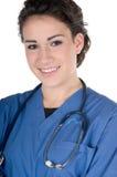 De jonge verpleegster, blauw schrobt en geïsoleerdek stethoscoop, Stock Afbeelding