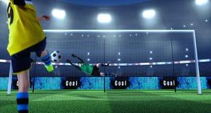 De jonge voetballer schopt bal terwijl de keeper verdedigt stock afbeeldingen