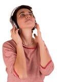 De jonge volwassen vrouw met kort haar een rode bovenkant, jeans op witte achtergrond in verschillend stelt, en diverse gelaatsui Stock Foto