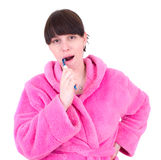 De jonge vrouw borstelt tanden Stock Foto