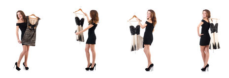 De jonge vrouw die nieuwe kleding op wit proberen Royalty-vrije Stock Afbeeldingen