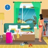 De jonge vrouw in een hotelruimte in een tropische toevlucht gaat naar Stock Foto's