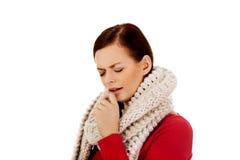 De jonge vrouw heeft een griep coughing stock foto