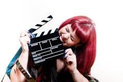 De jonge vrouw het bijten raad van de filmklep Royalty-vrije Stock Foto's