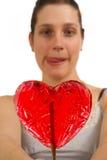 De jonge vrouw kan niet wachten om lolly te likken Royalty-vrije Stock Foto