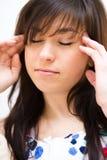 De vrouw lijdt aan hoofdpijn Stock Fotografie