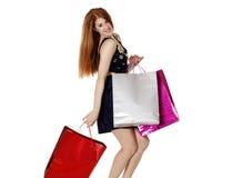 De jonge vrouw maakt het winkelen Stock Foto's