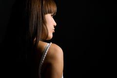 De jonge vrouw met bruin haar ? Stock Foto's