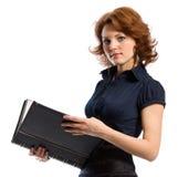 De jonge vrouw met documenten stock foto's