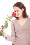 De jonge vrouw met een bloem Royalty-vrije Stock Afbeelding