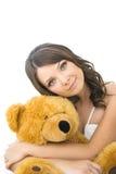 De jonge vrouw met het stuk speelgoed draagt Stock Afbeelding