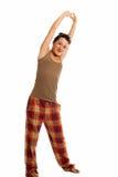 De jonge vrouw slaperig is dragend geïsoleerde pyjama's royalty-vrije stock foto