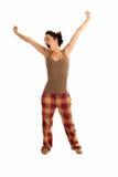 De jonge vrouw slaperig is dragend geïsoleerdeg pyjama's stock fotografie