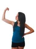 De jonge vrouw toont haar sterkte. geïsoleerdo op wit stock afbeelding