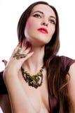 De jonge vrouw van de schoonheid met jewelery royalty-vrije stock foto