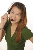 De jonge vrouwelijke klantendienst royalty-vrije stock afbeeldingen