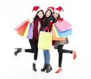 de jonge vrouwengroep geniet Kerstmis van het winkelen Royalty-vrije Stock Afbeelding