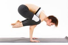 De jonge yoga van de vrouwenoefening Royalty-vrije Stock Afbeeldingen