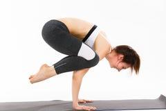 De jonge yoga van de vrouwenoefening Stock Afbeeldingen
