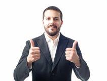 De jonge zakenman beduimelt omhoog Stock Foto's