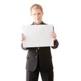De jonge zakenman houdt lege tekens. Royalty-vrije Stock Afbeeldingen