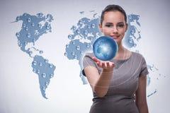De jongelui bisinesswoman in globaal bedrijfsconcept Stock Afbeeldingen
