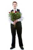 De jongen de tiener met een bos van bloemen Royalty-vrije Stock Foto's