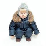 De jongen in de winteroverall Stock Afbeelding