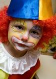 De jongen die clown draagt royalty-vrije stock fotografie