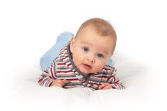 De jongen die van de baby uitdrukking heeft verrast Stock Afbeelding