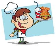 De Jongen die van de hamburger een Cheeseburger steunt Stock Fotografie